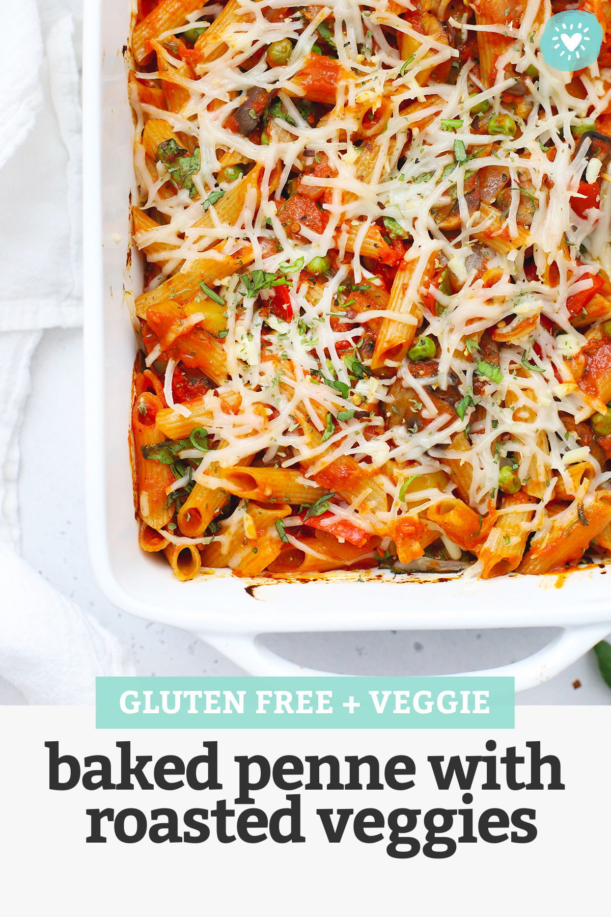 """Overhead view of a pan of baked penne with roasted veggies fresh from the oven with text overlay that reads """"Gluten-Free + Veggie Baked Penne with Roasted Veggies"""""""