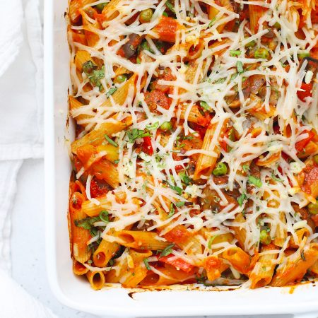 Overhead view of a pan of baked penne with roasted veggies fresh from the oven