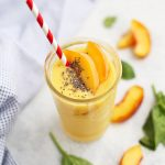 These Peach Mango Smoothies are like sipping liquid sunshine! Vegan and paleo to boot!