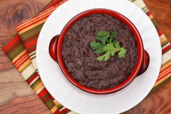Easy, delicious Homemade Refried Beans made in the slow cooker! from www.onelovelylife.com