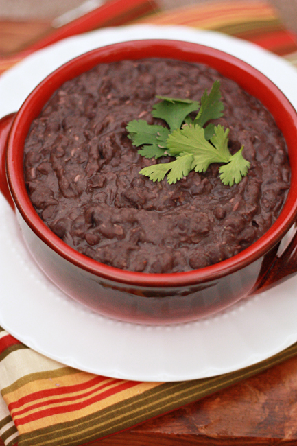 Slow Cooker Refried Beans - an easy, inexpensive way to kick up a Tex-Mex dinner! from www.onelovelylife.com