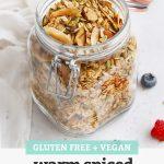 "Jar of Gluten Free Warm Spiced Granola with text overlay that reads ""Gluten-Free + Vegan Warm Spiced Granola - Easy + Yummy + Versatile"""