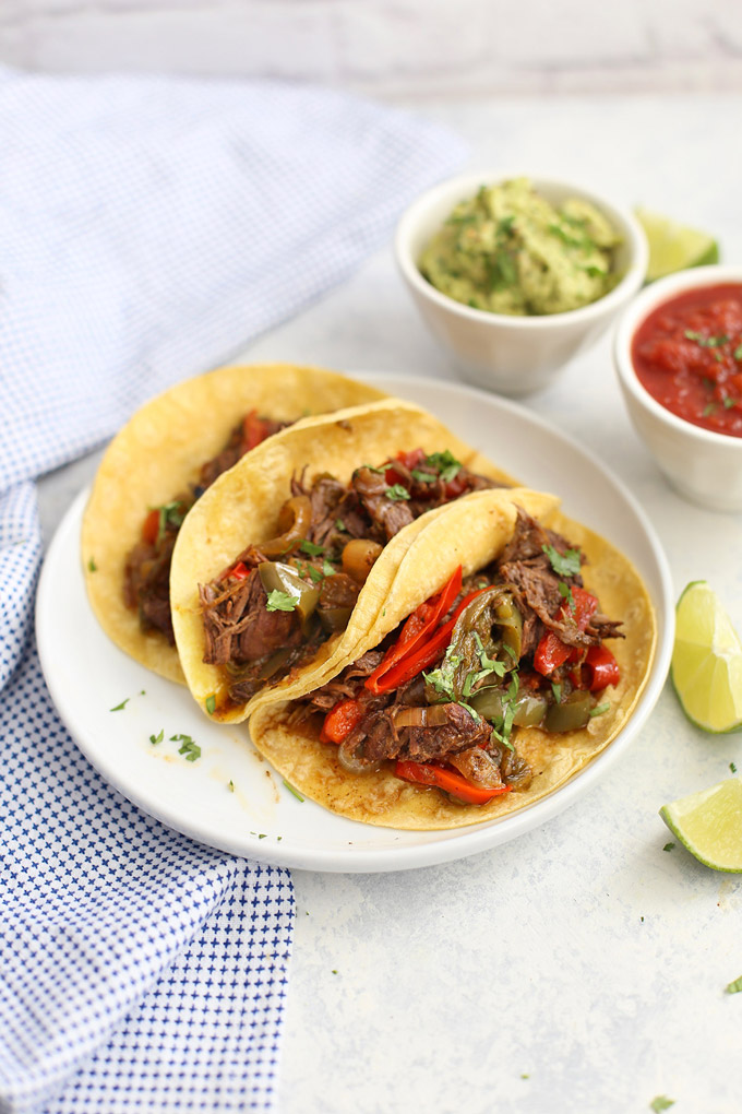Slow Cooker Beef Carnitas - Tender beef cooked in the crock pot! These make amazing tacos, burritos, burrito bowls, taco salads, and more! (gluten free, paleo friendly)