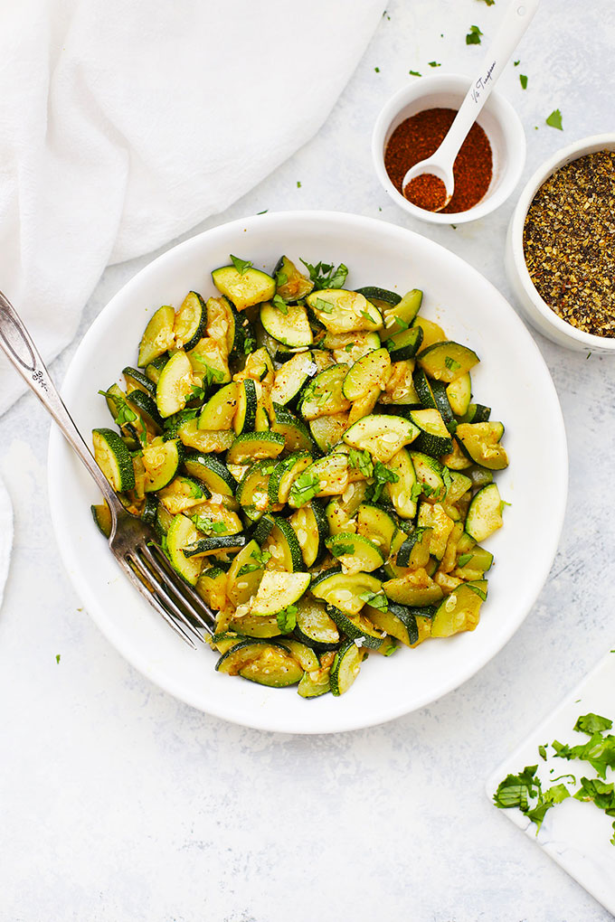 A white bowl of chili roasted zucchini from One Lovely Life