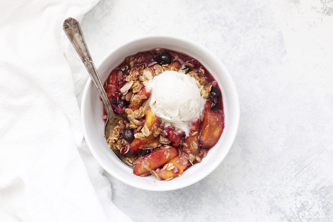 Gluten Free Vegan Peach Berry Crisp - The topping and filling are both amazing! Don't forget the ice cream!