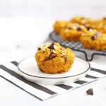Gluten Free Pumpkin Chocolate Chip Muffin on a plate with a striped napkin.