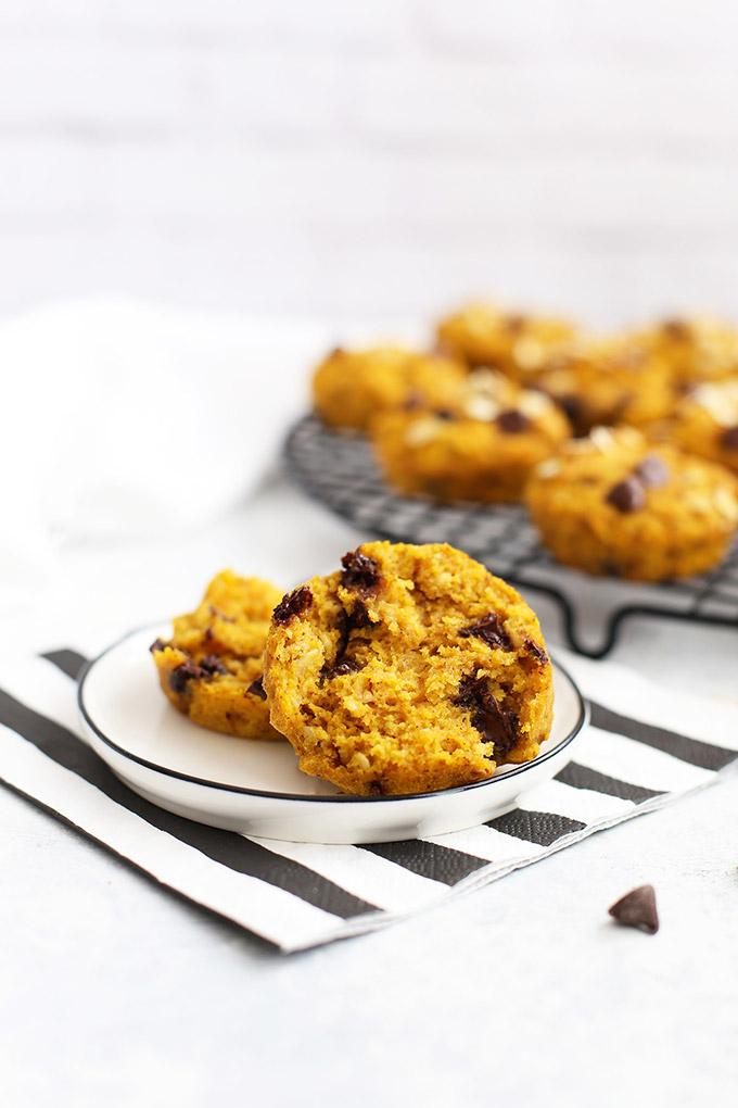 Split open gluten free pumpkin chocolate chip muffin on a plate