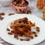 These Gluten Free Sweet Potato Waffles topped with maple candied pecans and syrup are a holiday breakfast dream come true. from www.onelovelylife.com