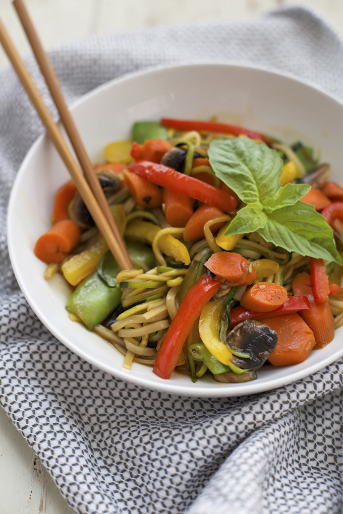 As tasty as it is pretty, we love this low carb veggie stir fry made with zucchini noodles.