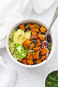 Chipotle Sweet Potato Burrito Bowl with green rice (arroz verde), black beans, avocado, and more.