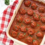 Baking dish full of One Lovely Life's perfect paleo meatballs in marinara.