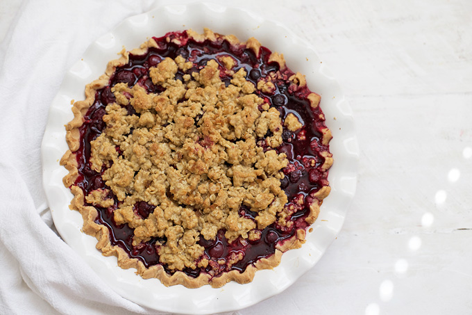 At home at your 4th of July BBQ or your Thanksgiving table, this Berry Crumble Pie is perfection.