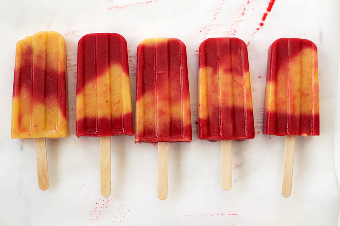 Swirl popsicles are the prettiest. Try these Peach & Raspberry Popsicles.
