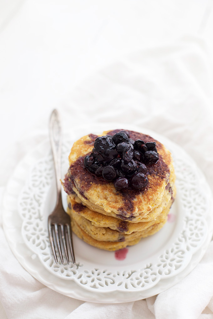 These cornmeal pancakes are crispy on the outside, and fluffy and airy on the inside. The blueberry maple syrup is incredible, too!