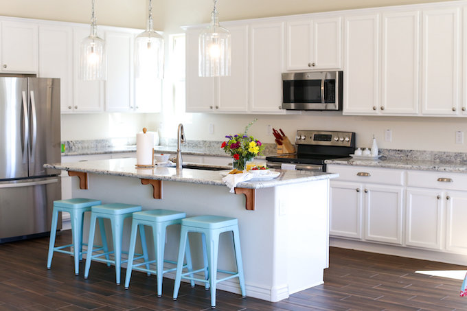 Our kitchen reveal! A peek at our (mostly) finished white kitchen. Open, bright, and we're so happy about it!