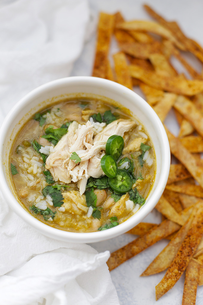 A bowl of this Salsa Verde Chicken and Rice Soup is just the thing for chilly days! Use leftover chicken or a rotisserie chicken for a quick shortcut!
