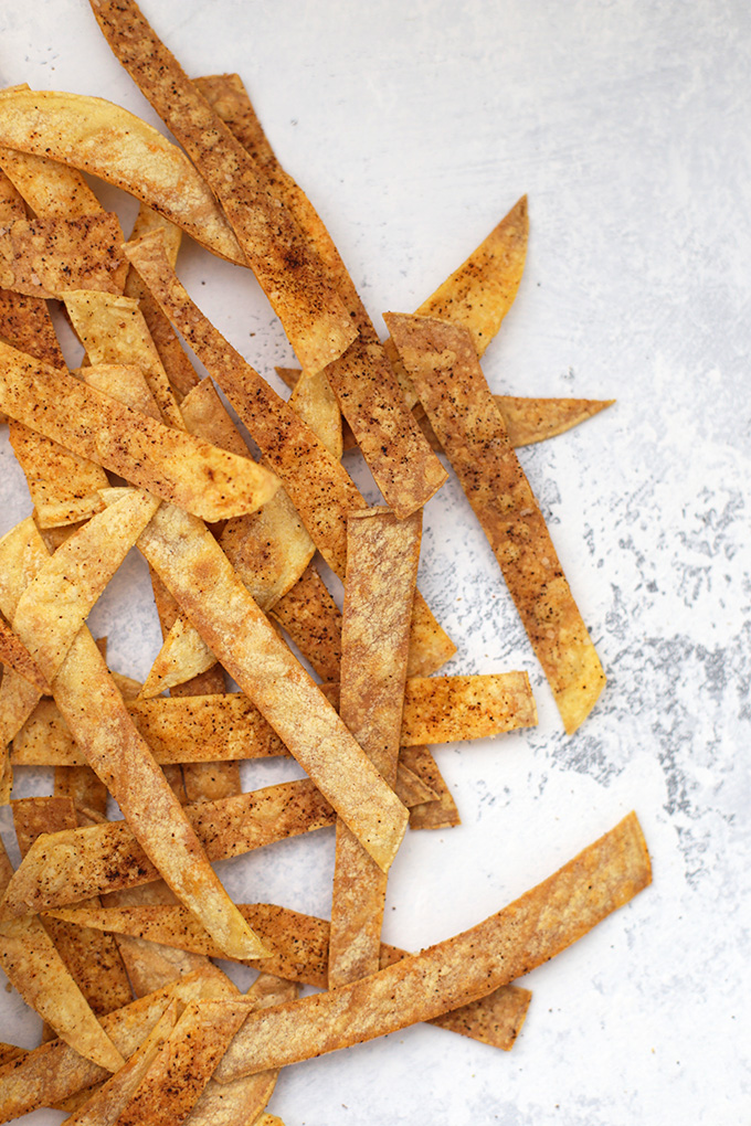 Crispy spiced tortilla strips are the BEST dipper for this Salsa Verde Chicken Soup.
