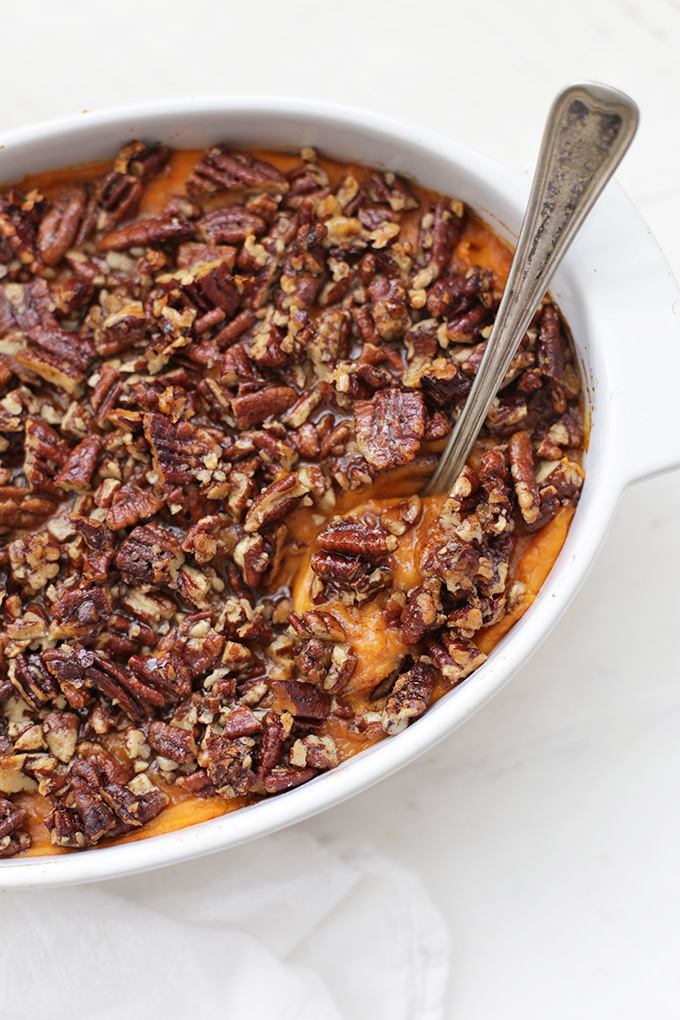 Paleo Sweet Potato Casserole has never looked so good. This one is naturally sweetened and has the most amazing pecan topping!