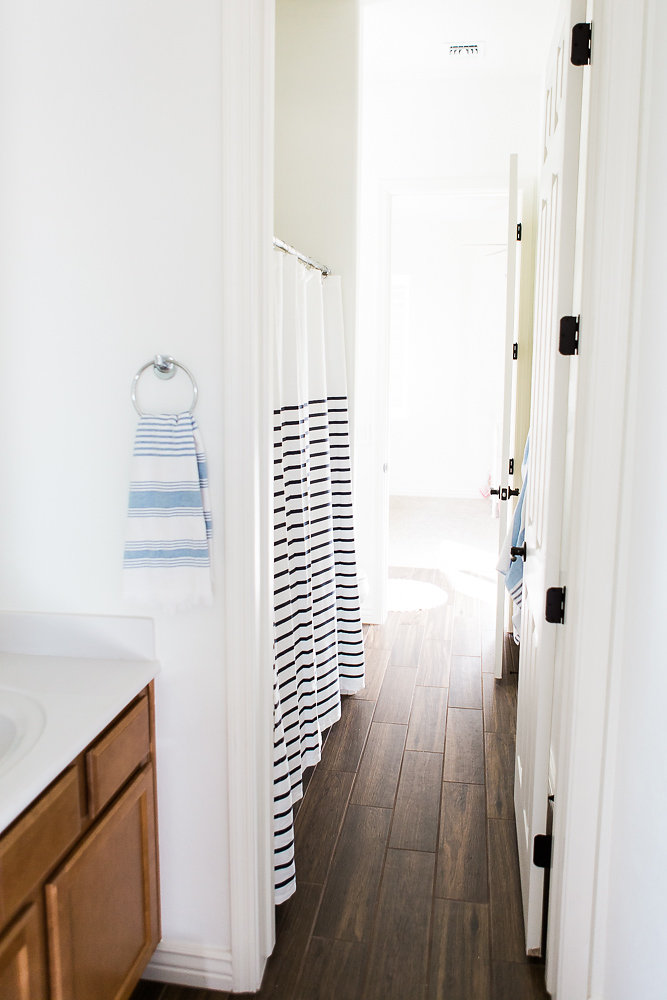 Boy and Girl Shared Bathroom. This is a great blend of masculine and feminine. So clean and bright!