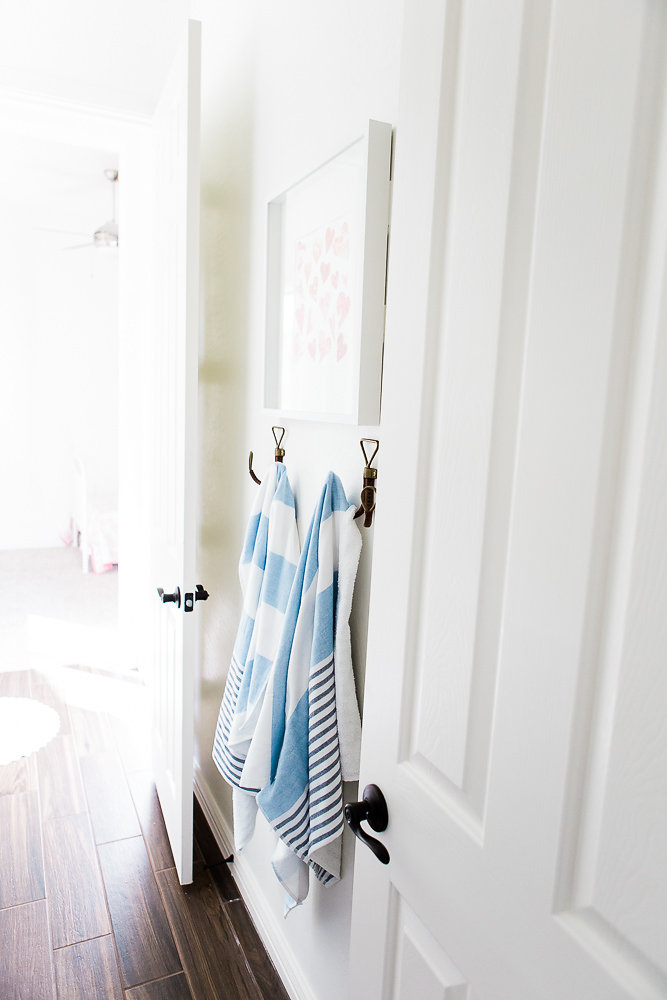 Soft Turkish bath towels soften up this Jack and Jill bathroom. We love these!