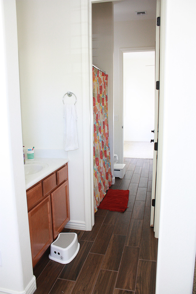 BEFORE: Our old bathroom design was mismatched and hand-me-down. Click through to see our updated Jack and Jill Bathroom. It's so crisp and bright!
