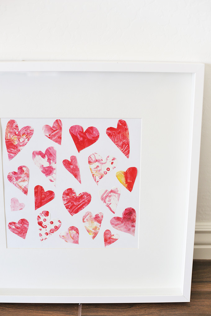 An easy homemade piece of art - The kids painted paper and I cut out little hearts. Simple and sweet!