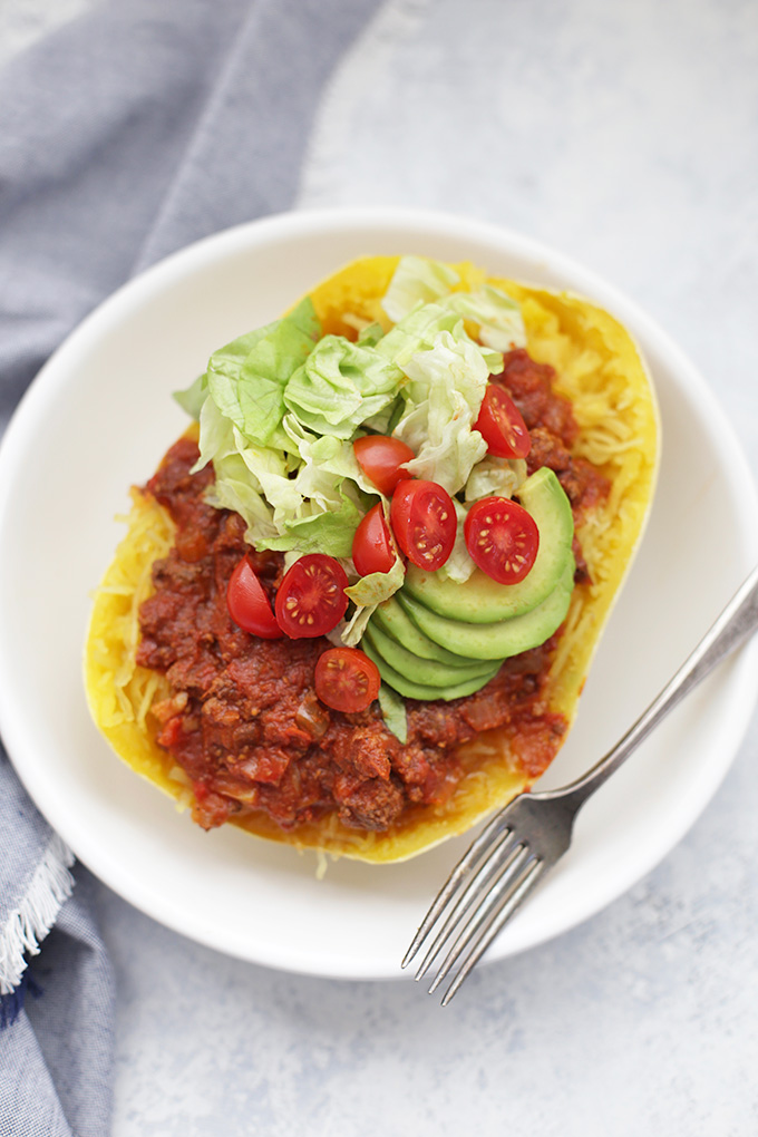 Chili Stuffed Squash - A perfect paleo or vegan dinner you can top with your favorite taco toppings!