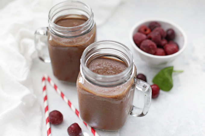Grab a straw and dive in! Paleo Chocolate Cherry Smoothies taste like dessert but are made from clean ingredients.