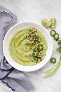 This bright, flavorful cilantro hummus is a perfect healthy dip! Use it for snacks, lunches, parties, or game day!