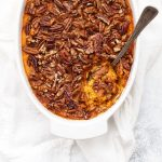 Overhead view of paleo sweet potato casserole with a spoon in it.