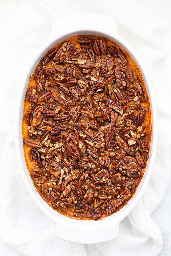 Overhead view of paleo sweet potato casserole with pecan topping.