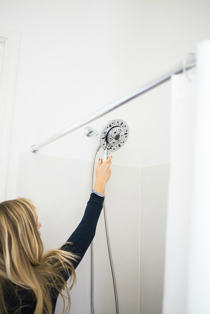 One simple swap for a better bathroom: Update your shower head! This one is the Delta In2Ition. It's got amazing water pressure and can be used so many ways!