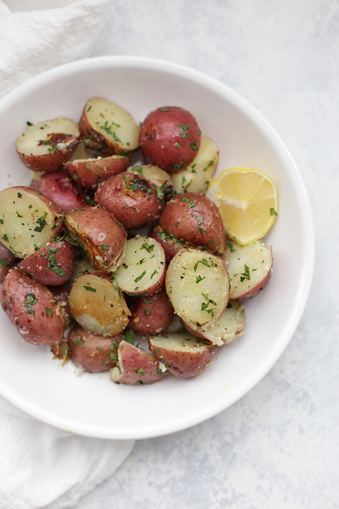 Did you know you can cook potatoes in a rice cooker? These perfectly cooked potatoes are dressed up with Lemon, fresh herbs, and simple seasonings to make a perfect side dish for dinner.