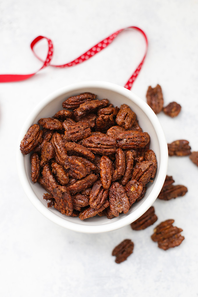 These homemade candied pecans have all the amazing crunchy texture and sweet flavor without the sugar crash. Sweetened with coconut sugar, they're a cleaner way to enjoy this treat!
