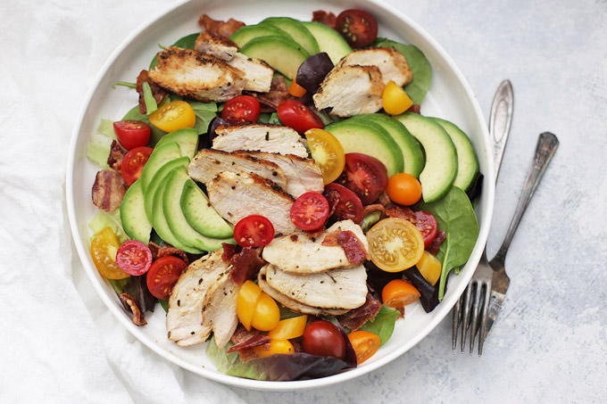 Rosemary Chicken BLT Salad - This salad is anything but boring. Flavorful chicken with an herby crust, crispy bacon, colorful tomatoes, and a dynamite dressing. It's everything I'm looking for.