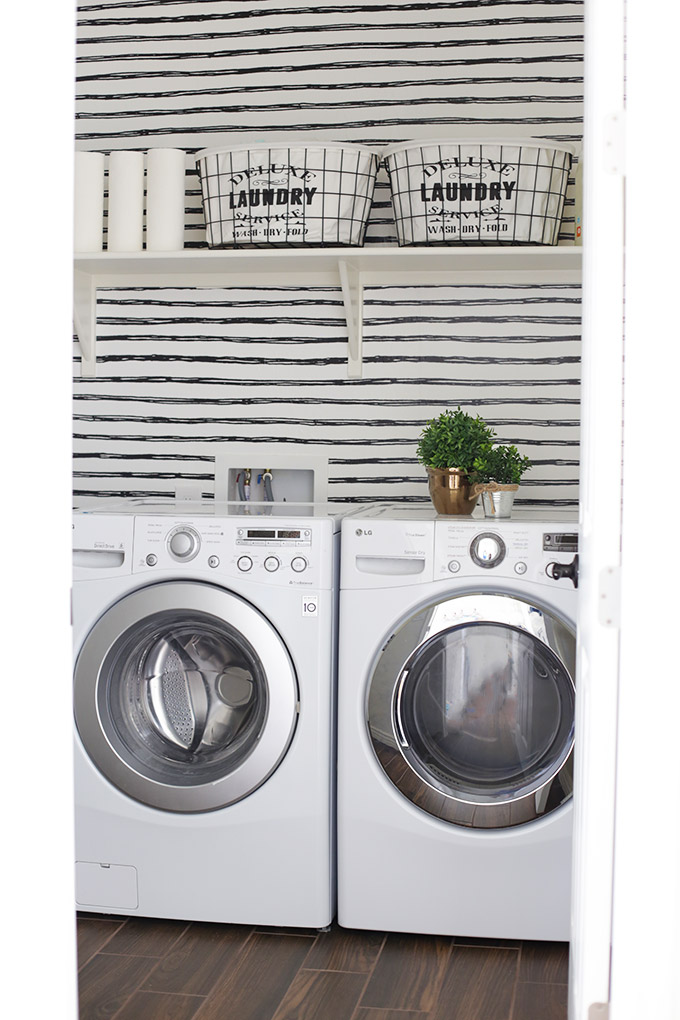 Laundry Room Organization on a Budget - Updating a basic laundry room without breaking the bank!