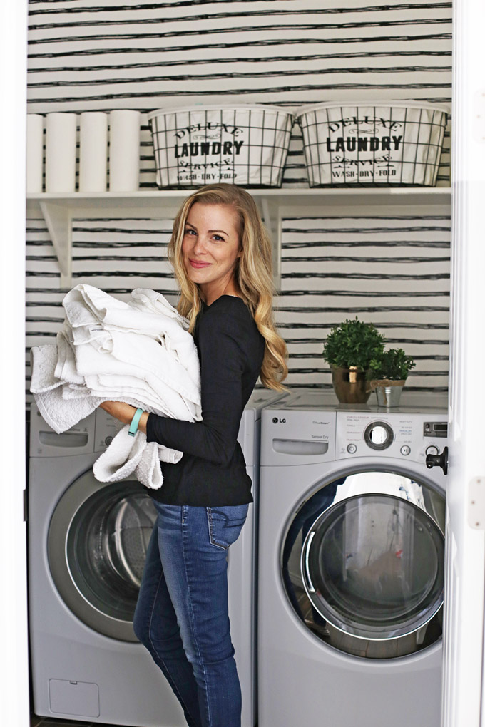 Laundry Room Organization on a budget - We totally revamped our laundry room without breaking the bank. I love how it turned out!