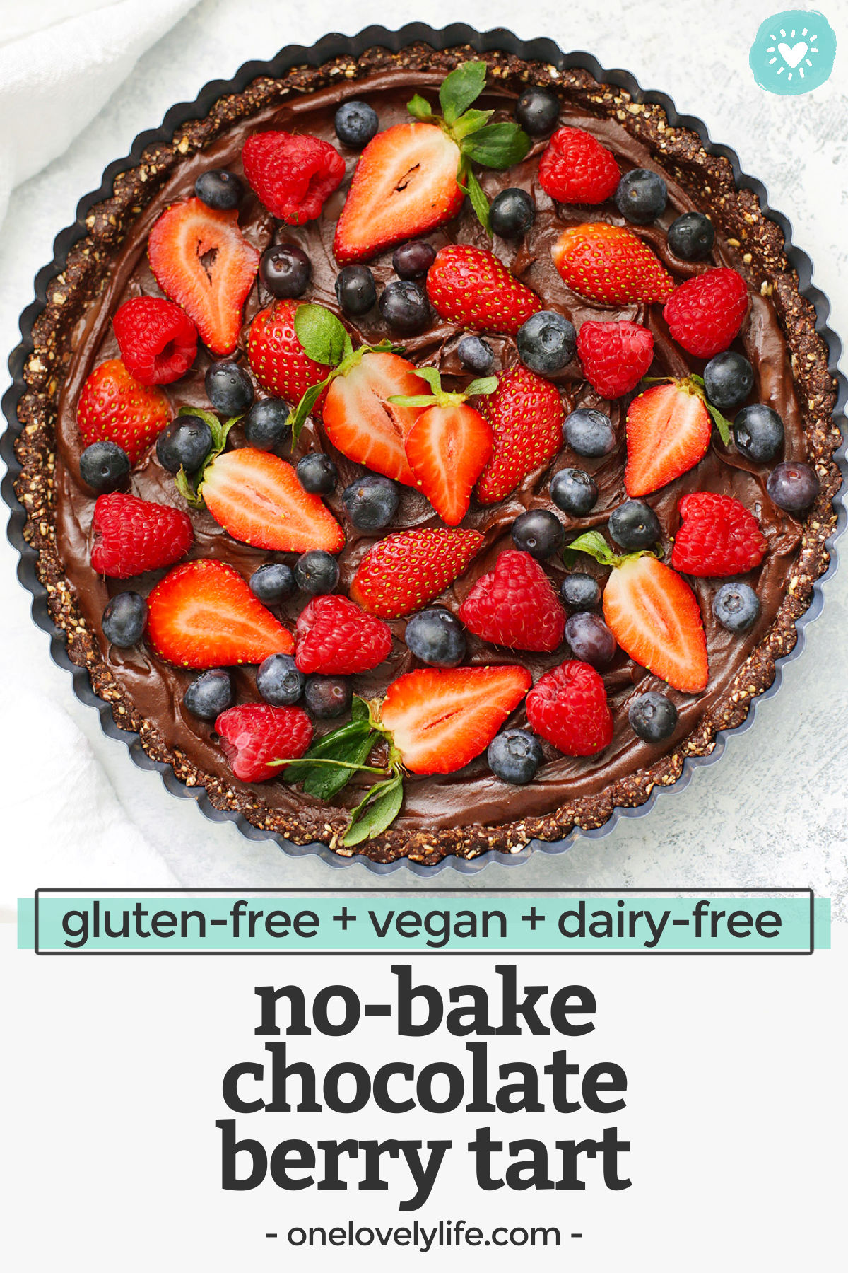 No BakeChocolate Berry Tart - This gluten free vegan chocolate tart tastes so fresh and luscious.It's gluten free, dairy free, refined sugar free, and really makes a statement. The belle ofthe ball at any dinner or party!// Dairy free chocolate tart // gluten free chocolate tart // no bake desserts // Valentine's Day Dessert #chocolate #tart #valentinesday #glutenfree #vegan