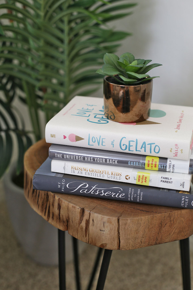 The perfect side table for a stack of books. We love this little book nook!