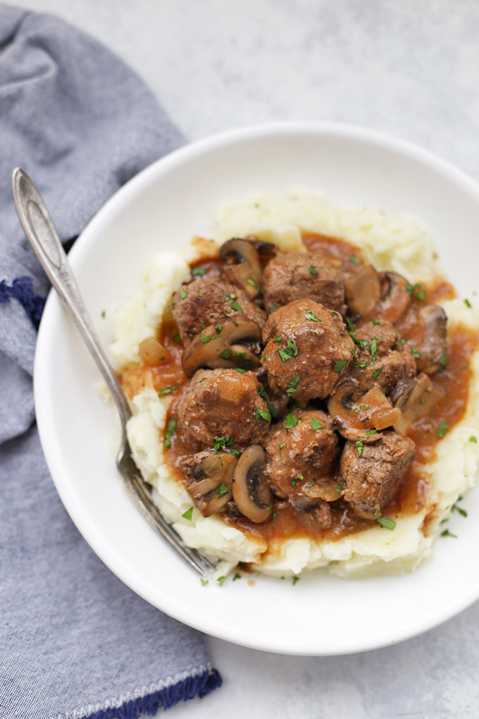 Salisbury Steak Meatballs - Good old fashioned comfort food. These meatballs are cozy and satisfying on their own, but they also pair beautifully with mashed potatoes or cauliflower mash. You'll want to dive right in!