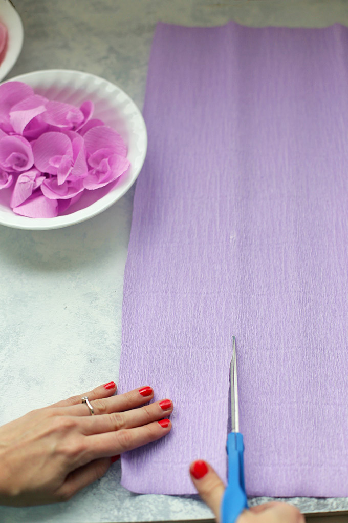 Cutting crepe paper into strips to make crepe paper wisteria