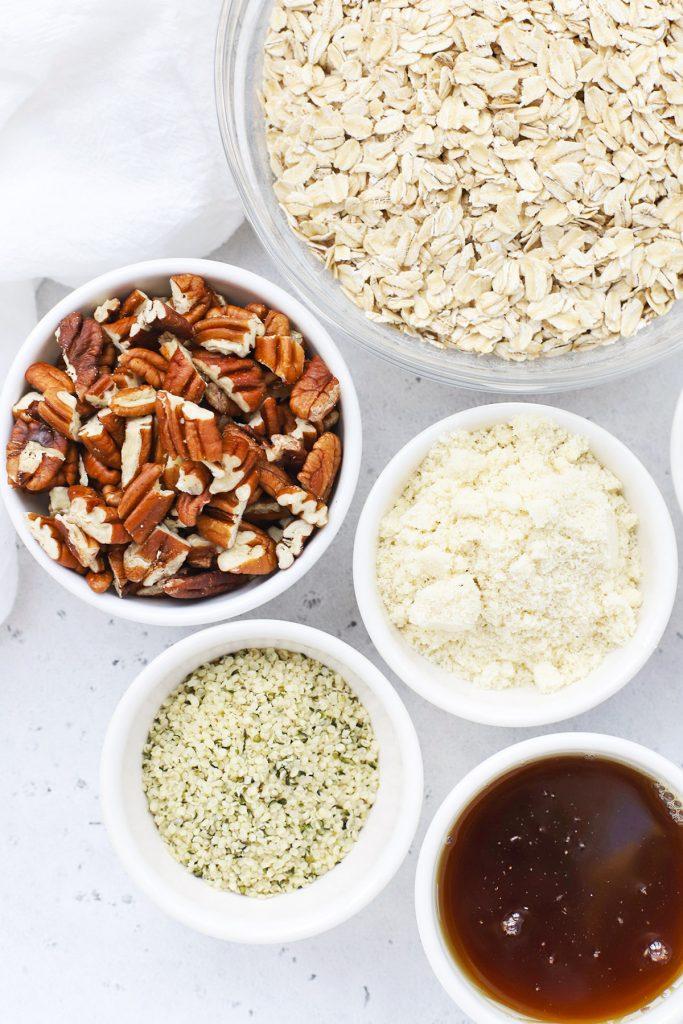 Overhead view of ingredients for maple pecan granola