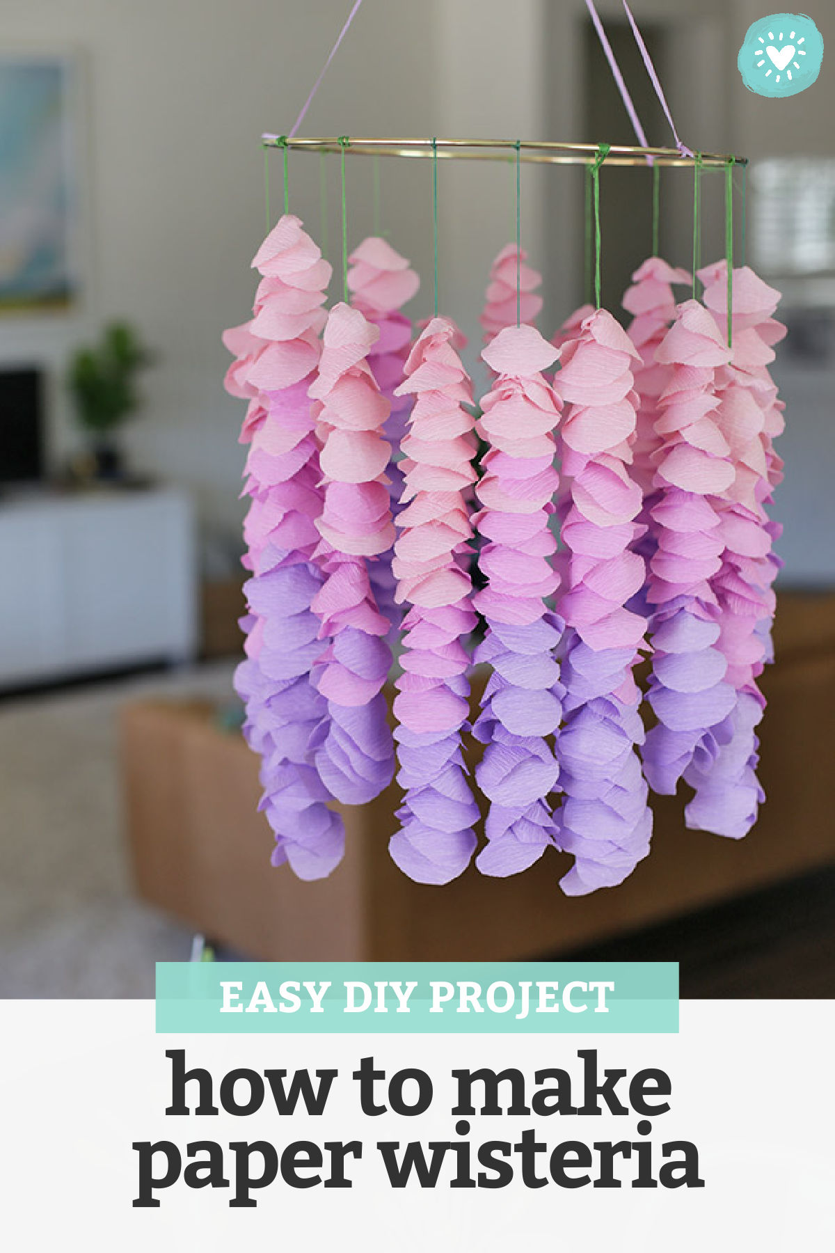 "Crepe Paper Wisteria Hanging from a Gold Embroidery Hoop with text overlay that reads ""Easy DIY Project - How to Make Paper Wisteria"""