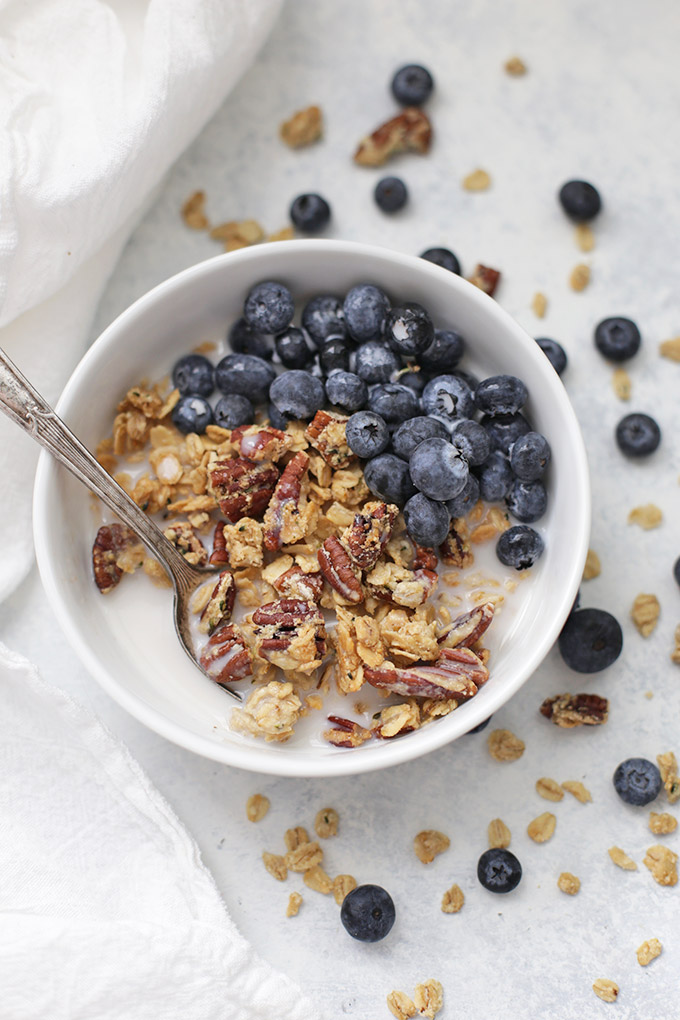 We LOVE granola. This Maple Pecan Granola is gluten free, vegan, and naturally sweetened.