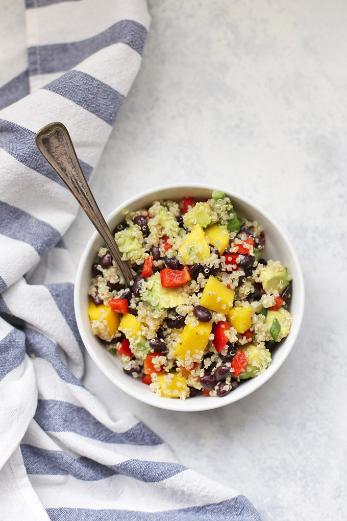 This Confetti Quinoa Salad is the perfect lunch or side dish - Mango, avocado, and lime dressing. It's the best!