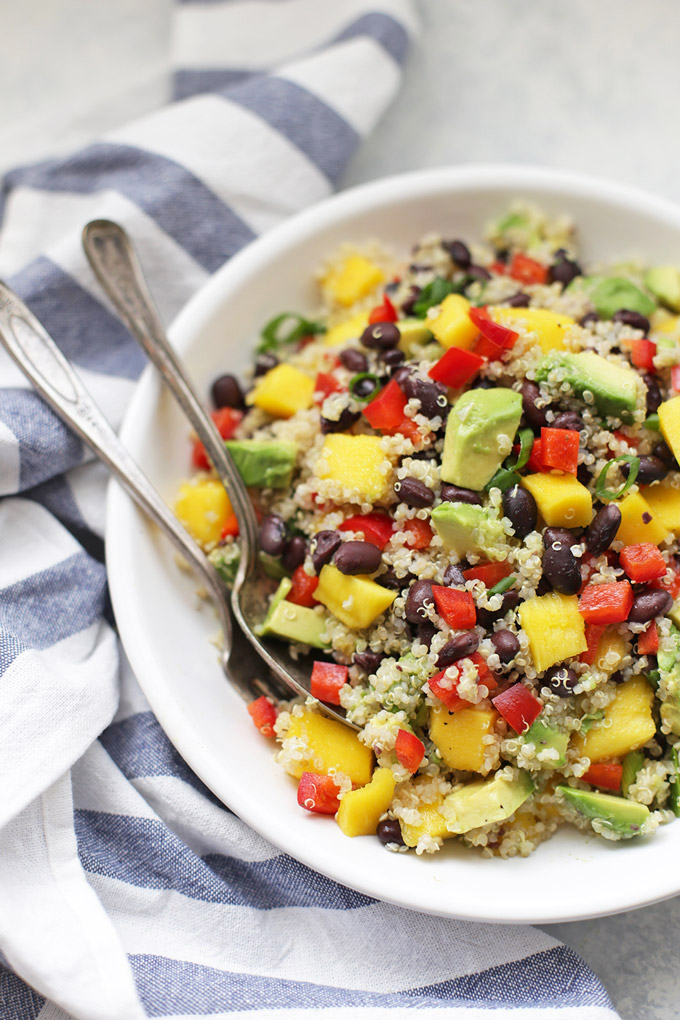 Confetti Quinoa Salad - One of my family's all time favorite recipes, this fresh, colorful quinoa salad is perfect for picnics, potlucks, barbecues, lunches, meal prep, and more!