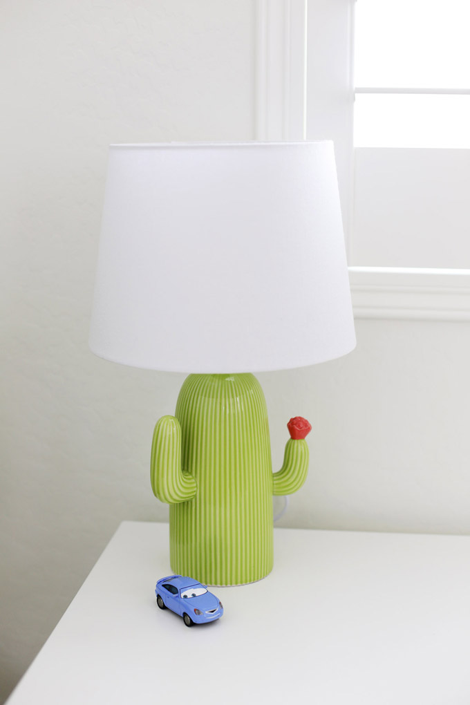 The cutest cactus lamp. Love how it brightens up this black and white bedroom!