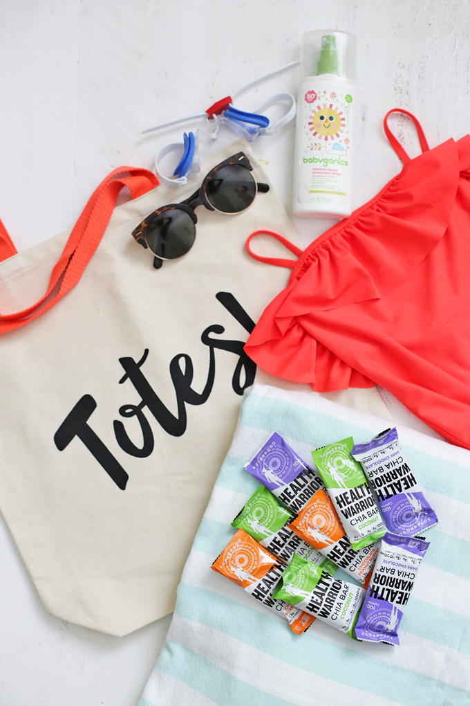 How We're Winning Summer - Keeping our pool bag packed with towels, goggles, sunscreen, and snacks (like these @healthwarrior bars!)