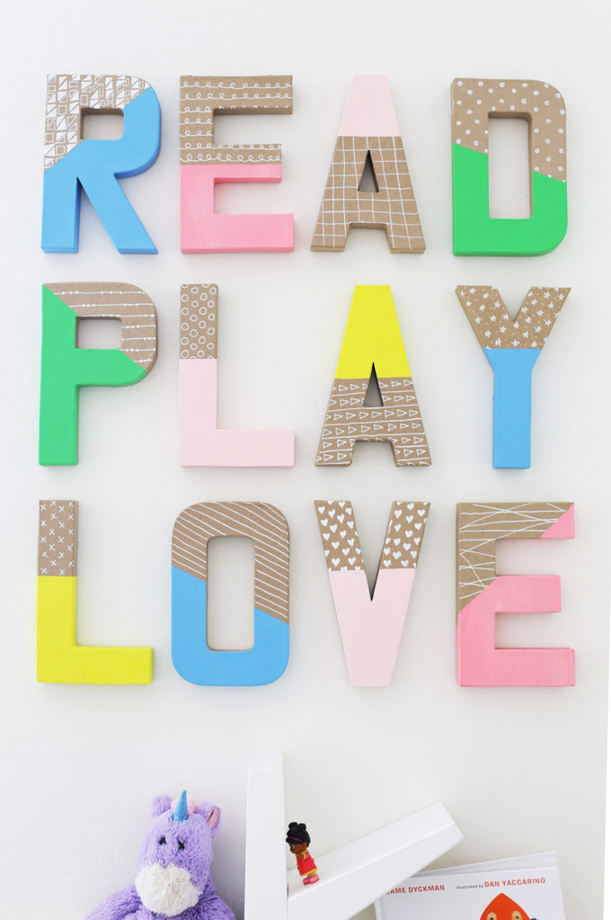 "DIY Painted Wall Letters on a playroom wall that spell out ""Read, Play, Love"""