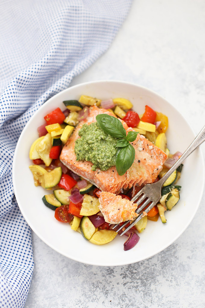 Sheet Pan Pesto Salmon and Veggies - There's nothing easier than a one pan dinner! This sheet pan meal is a family favorite, loaded with color and flavor!